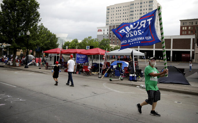 Mike Pellerin joins other Trump supporters on 4th Street and Cheyenne Ave. in downtown Tulsa, Okla., ahead of President Donald Trump's Saturday's campaign rally Friday, June 19, 2020. (Mike Simons/Tulsa World via AP)