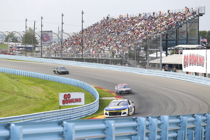 Chase Elliott (9) turns into the Esses ahead of Brad Keselowski and Kurt Busch (1) during a NASCAR Cup Series auto race in Watkins Glen, N.Y., on Sunday, Aug. 8, 2021. (AP Photo/Joshua Bessex)