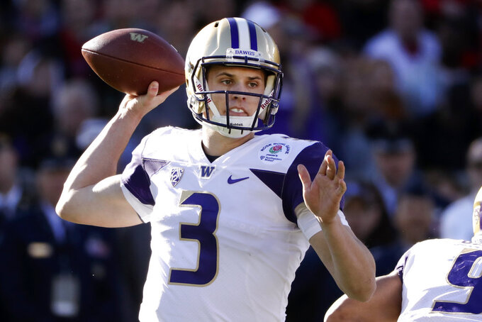 Washington quarterback Jake Browning passes against Ohio State during the first half of the Rose Bowl NCAA college football game Tuesday, Jan. 1, 2019, in Pasadena, Calif. (AP Photo/Jae C. Hong)