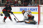 Carolina Hurricanes center Sebastian Aho, left, of Finland, misses a shot on goal against Anaheim Ducks goaltender Ryan Miller (30) during the second period of an NHL hockey game in Raleigh, N.C., Friday, Jan. 17, 2020. (AP Photo/Gerry Broome)