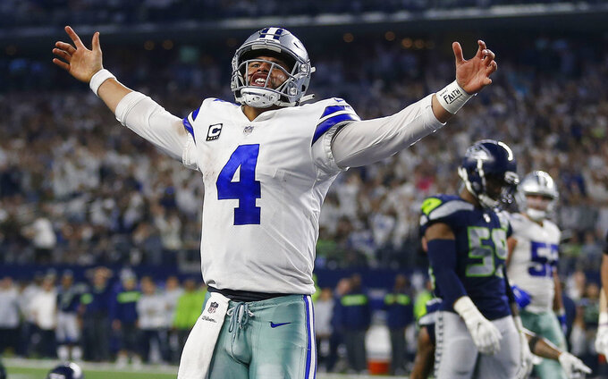 Dallas Cowboys quarterback Dak Prescott (4) celebrates his first down near the goal line against the Seattle Seahawks during the second half of the NFC wild-card NFL football game in Arlington, Texas, Saturday, Jan. 5, 2019. (AP Photo/Ron Jenkins)