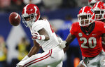 Alabama wide receiver Jerry Jeudy (4) works to recover his fumble as Georgia defensive back J.R. Reed (20) looks on during the second half of the Southeastern Conference championship NCAA college football game, Saturday, Dec. 1, 2018, in Atlanta. (AP Photo/John Bazemore)
