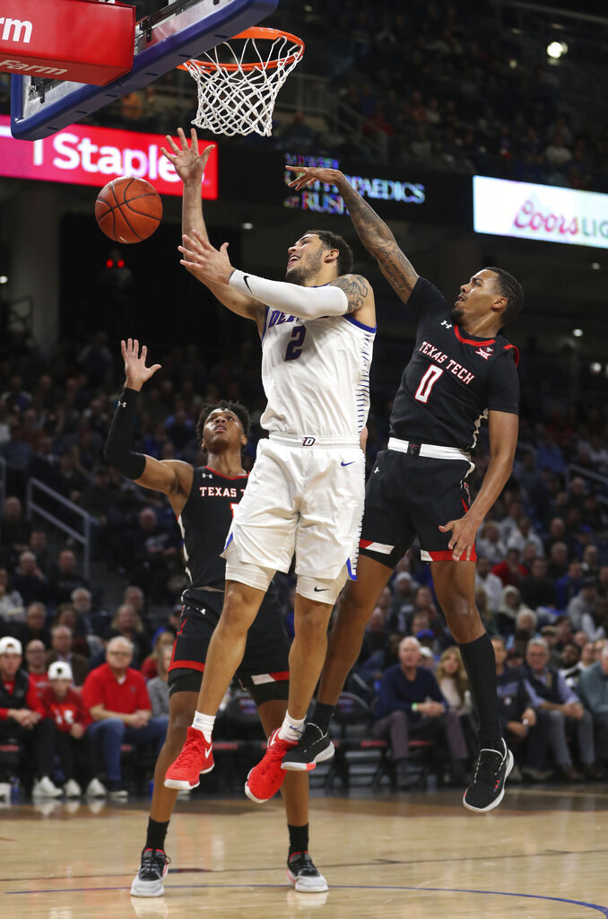 DePaul forward Jaylen Butz (2) loses control of the ball as Texas Tech's Kyler Edwards (0) and a teammate defend during the first half of an NCAA college basketball game in Chicago on Wednesday, Dec. 4, 2019. (Chris Sweda/Chicago Tribune via AP)