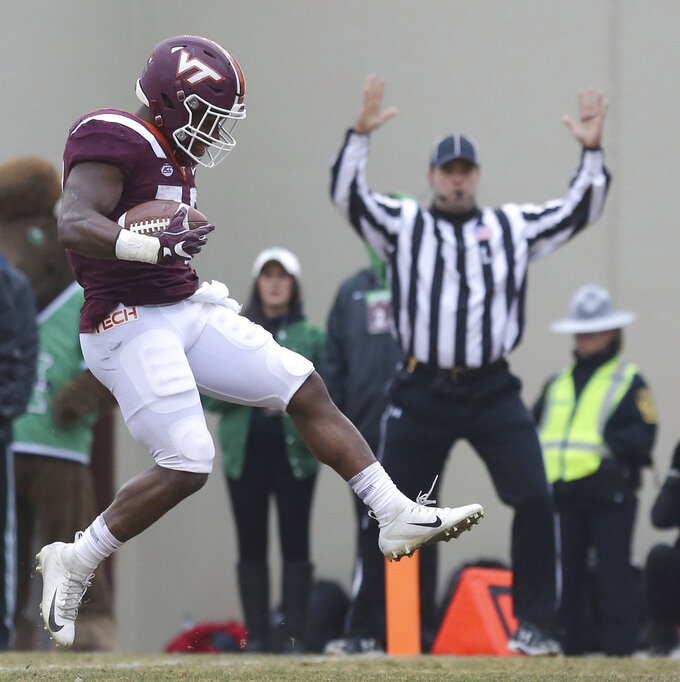 Steven Peoples (32) of Virginia Tech steps into the end zone on a seven- yard touchdown play in the second quarter of an NCAA college football game in Blacksburg Va. Saturday, Dec. 1 2018. (Matt Gentry/The Roanoke Times via AP)