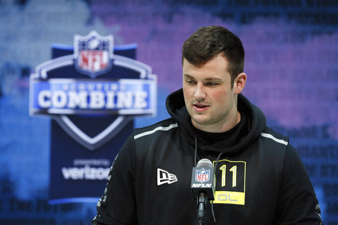 FILE - In this Feb. 26, 2020, file photo, Boise State offensive lineman Ezra Cleveland speaks during a press conference at the NFL football scouting combine in Indianapolis. Cleveland is a possible pick in the NFL Draft which runs Thursday, April 23, 2020, thru Saturday, April 25.  (AP Photo/Charlie Neibergall, File)