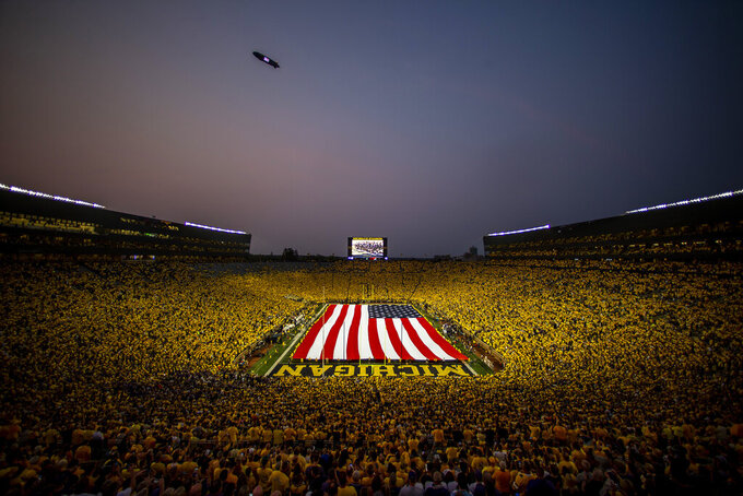 Michigan Stadium attendees remember the 20th anniversary of the Sept. 11, 2001, terrorist attacks before an NCAA college football game between Washington and Michigan in Ann Arbor, Mich., Saturday, Sept. 11, 2021. (AP Photo/Tony Ding)