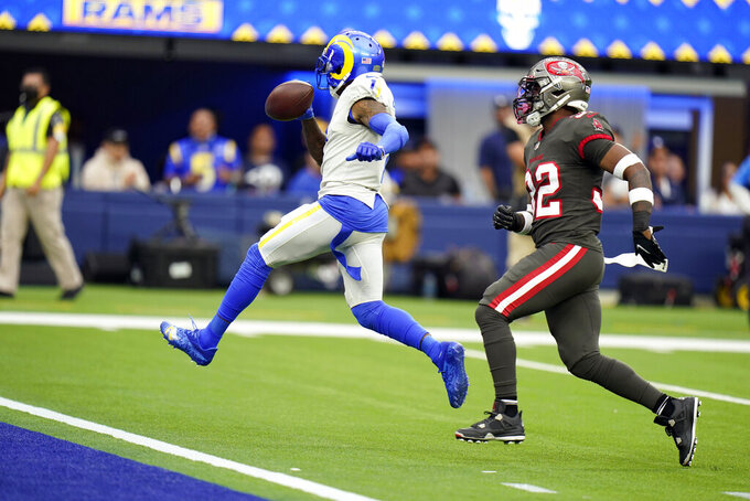Los Angeles Rams wide receiver DeSean Jackson left, scores a touchdown past Tampa Bay Buccaneers safety Mike Edwards during the second half of an NFL football game against the Tampa Bay Buccaneers Sunday, Sept. 26, 2021, in Inglewood, Calif. (AP Photo/Jae C. Hong)