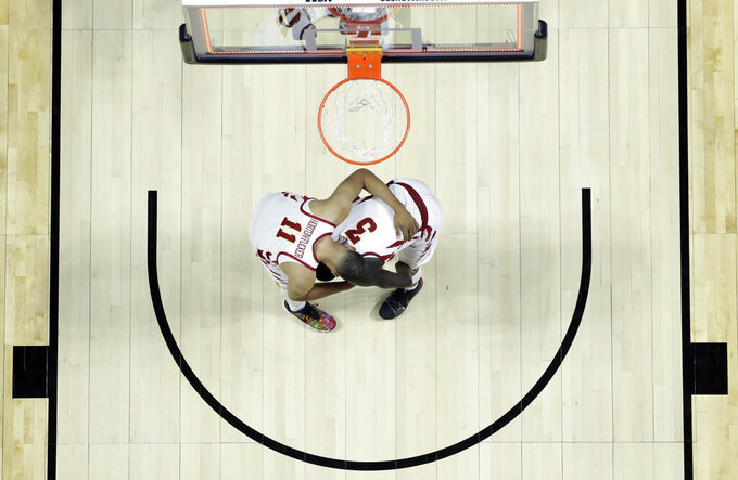 Iowa State's Talen Horton-Tucker (11) consoles teammate Marial Shayok (3) after a 62-59 loss to Ohio State during a first round men's college basketball game in the NCAA Tournament Friday, March 22, 2019, in Tulsa, Okla. (AP Photo/Jeff Roberson)
