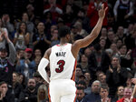 Miami Heat guard Dwyane Wade acknowledges the crowd as he enters during the first half of the team's NBA basketball game against the Portland Trail Blazers in Portland, Ore., Tuesday, Feb. 5, 2019. This will likely be his final game in Portland as he is set to retire at the end of the season. (AP Photo/Steve Dykes)