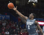 Mississippi State forward Reggie Perry (1) goes after a rebound during the first half of an NCAA college basketball game in Oklahoma City, Saturday, Jan. 25, 2020. (AP Photo/Kyle Phillips)