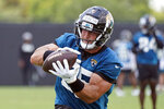FILE - Jacksonville Jaguars tight end Tim Tebow catches a pass during NFL football practice in Jacksonville, Fla., in this Thursday, May 27, 2021, file photo. Tebow's far from the spotlight, right where coach Urban Meyer wants the 2007 Heisman Trophy winner for now. (AP Photo/John Raoux, File)