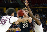 Colorado forward Lucas Siewert (23) tries to pass the ball as Arizona State's Taeshon Cherry (35) and Luguentz Dort (0) defend during the first half of an NCAA college basketball game, Saturday, Jan. 5, 2019, in Tempe, Ariz. (AP Photo/Ralph Freso)