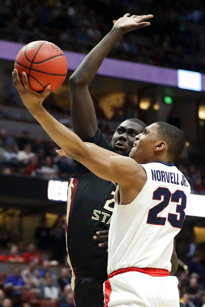Gonzaga guard Zach Norvell Jr., right, shoots past Florida State center Christ Koumadje during the second half an NCAA men's college basketball tournament West Region semifinal Thursday, March 28, 2019, in Anaheim, Calif. (AP Photo/Marcio Jose Sanchez)