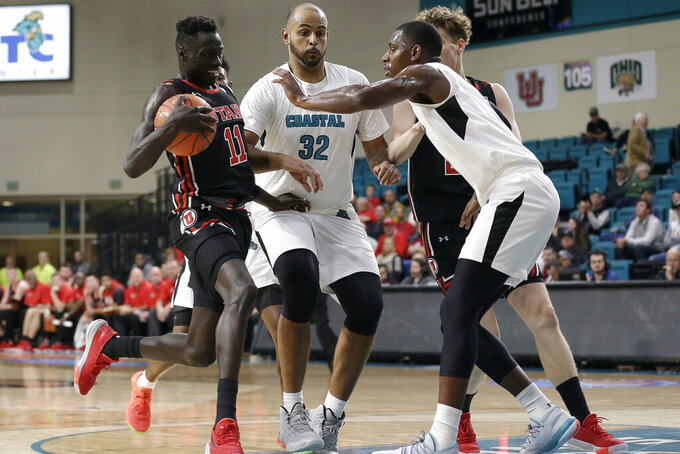 Coastal Carolina forward Isaac Hippolyte, right, and center Levi Cook (32) defend against Utah guard Both Gach (11) during the first half of an NCAA college basketball game at the Myrtle Beach Invitational in Conway, S.C., Thursday, Nov. 21, 2019. (AP Photo/Gerry Broome)