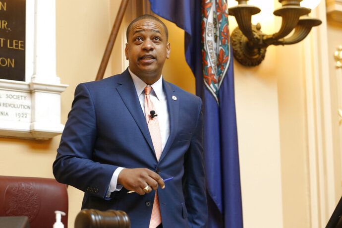 FILE  - In this Tuesday July 9, 2019 file photo, Virginia Lt. Gov. Justin Fairfax welcomes visitors at the start of the special session on gun issues at the State Capitol in Richmond, Va. An attorney for Virginia Lt. Gov. Justin Fairfax says there is a witness who can corroborate his story that he did not rape a woman while they were students at Duke University nearly 20 years ago. (AP Photo/Steve Helber, File)