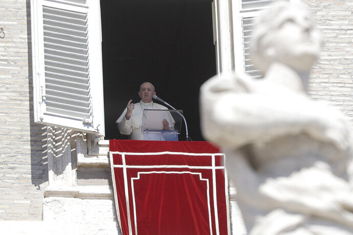 Pope Francis recites the Angelus noon prayer from his studio window overlooking St. Peter's Square, at the Vatican, Sunday, Sept. 6, 2020. (AP Photo/Gregorio Borgia)