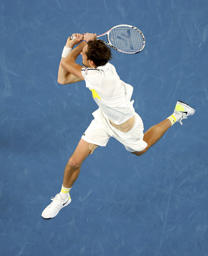 Russia's Daniil Medvedev hits a backhand to Serbia's Novak Djokovic during the men's singles final at the Australian Open tennis championship in Melbourne, Australia, Sunday, Feb. 21, 2021. (AP Photo/Hamish Blair)