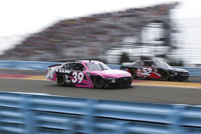 Ryan Sieg (39) and David Smith drive between Turn 1 and the Esses in the NASCAR Xfinity Series auto race at Watkins Glen International in Watkins Glen, N.Y., on Saturday, Aug. 7, 2021. (AP Photo/Joshua Bessex)