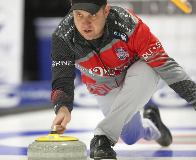 FILE - In this Feb. 9, 2019, file photo, John Shuster delivers a stone during the 2019 USA Curling Nationals at Wings Event Center in Kalamazoo, Mich. Nearly a year has passed since he won gold in South Korea, and Shuster can still smile about his transformation from obscure curler to Olympic sensation. The past 12 months have certainly been eventful for him and his teammates. (Emil Lippe/Kalamazoo Gazette via AP, File)