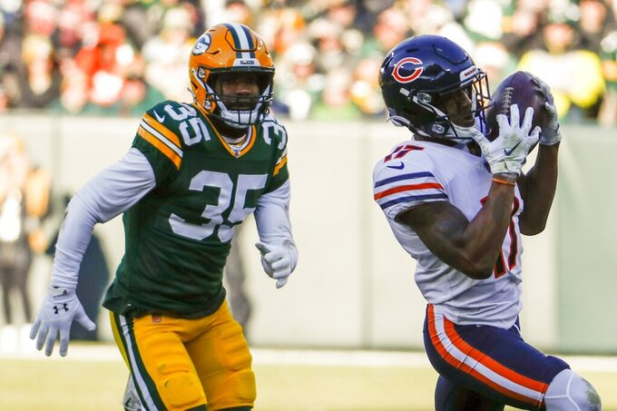 Chicago Bears' Anthony Miller catches a pass in front of Green Bay Packers' Ibraheim Campbell during the first half of an NFL football game Sunday, Dec. 15, 2019, in Green Bay, Wis. (AP Photo/Matt Ludtke)