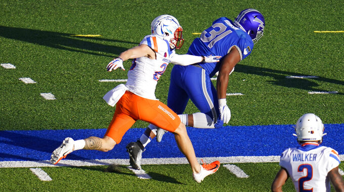 Boise State guard Kekaula Kaniho, left, pushes Air Force fullback Elijah Robinson out of bounds after a long gain in the first half of an NCAA college football game Saturday, Oct. 31, 2020, at Air Force Academy, Colo. (AP Photo/David Zalubowski)