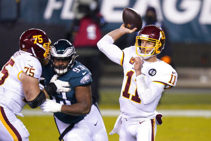 Washington Football Team's Alex Smith passes during the first half of an NFL football game against the Philadelphia Eagles, Sunday, Jan. 3, 2021, in Philadelphia. (AP Photo/Chris Szagola)