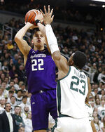 Northwestern forward Pete Nance (22) shoots over Michigan State forward Xavier Tillman (23) during the first half of an NCAA college basketball game, Wednesday, Jan. 29, 2020, in East Lansing, Mich. (AP Photo/Carlos Osorio)
