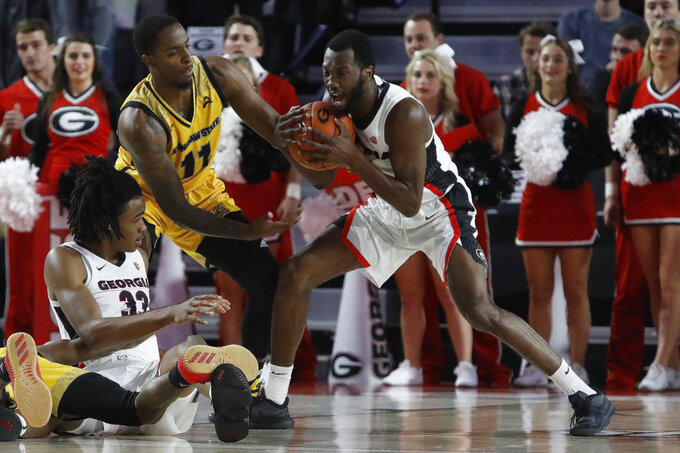 Georgia guard William Jackson II (0) fights Kennesaw State guard Kyle Clarke (11) for possession of the ball during an NCAA college basketball game in Athens, Ga., Tuesday, Nov. 27, 2018. (Jenn Finch/Athens Banner-Herald via AP)