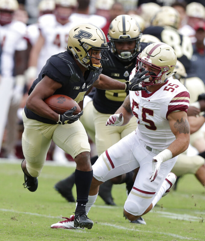 Purdue wide receiver Rondale Moore (4) pushes off Boston College linebacker Isaiah McDuffie (55) during the first half of an NCAA college football game in West Lafayette, Ind., Saturday, Sept. 22, 2018. (AP Photo/Michael Conroy)