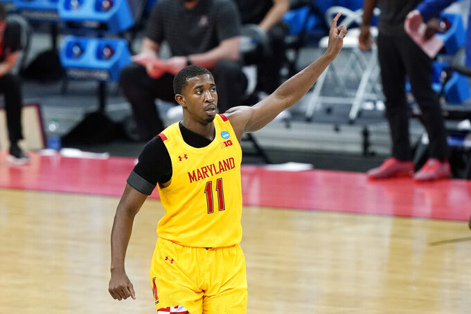 Maryland's Darryl Morsell (11) celebrates after scoring against Alabama during the first half of a college basketball game in the second round of the NCAA tournament at Bankers Life Fieldhouse in Indianapolis Monday, March 22, 2021. (AP Photo/Mark Humphrey)