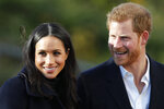 FILE - In this Dec. 1, 2017 file photo, Britain's Prince Harry and his fiancee Meghan Markle arrive at Nottingham Academy in Nottingham, England. The child of Meghan Markle and Prince Harry will be seventh in the line of succession to the British throne, and also could be an American. The baby expected to arrive in the next few weeks would be the first citizen of Britain's former colonies born into the upper echelons of the royal family. (AP Photo/Frank Augstein, File)