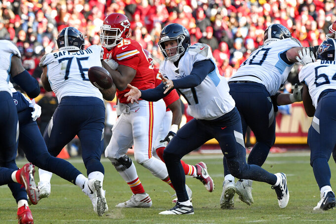 FILE - In this Jan. 19, 2020, file photo, Tennessee Titans quarterback Ryan Tannehill (17) pitches the ball during the first half against the Kansas City Chiefs in NFL football's AFC championship game in Kansas City, Mo. The Titans need depth on the offensive line and made Nate Davis, a third-round pick out of Charlotte a year ago, the starter at right guard midway through the season. (AP Photo/Ed Zurga, File)