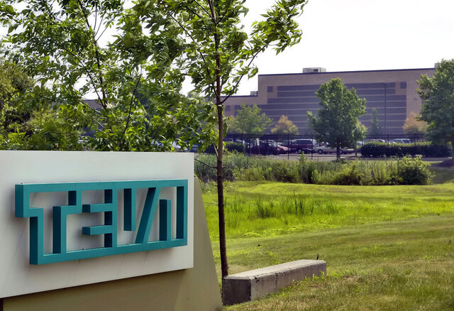 FILE - In this July 25, 2005 file photo, the offices of Teva Pharmaceuticals North America are seen in Horsham, Pa. At least a half-dozen companies that make or distribute prescription opioid painkillers are facing a federal criminal investigation of their roles in a nationwide addiction and overdose crisis. The Wall Street Journal first reported the investigation Tuesday, Nov. 26, 2019, citing unnamed sources familiar with the probe. (AP Photo/George Widman, File)