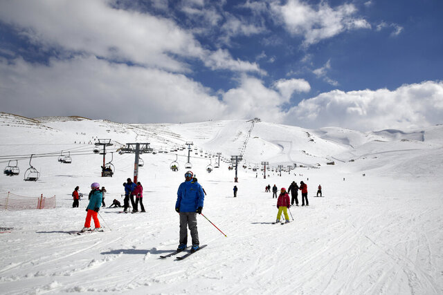"FILE - In this Friday, Feb. 22, 2019 file photo, people ride ski lifts as other skiers slide down the hill on a sunny day at the Faraya-Mzaar ski resort, in Faraya, northeast of Beirut, Lebanon. As several countries have suspended access to the ski slopes to stop the spread of the coronavirus pandemic, the World Health Organization's emergencies chief said the risk of catching COVID-19 while skiing is likely minimal. ""I suspect many people won't be infected barreling down the slopes on their skis,"" said Dr. Michael Ryan at a WHO news briefing on Monday, Nov, 30, 2020. (AP Photo/Bilal Hussein, file)"