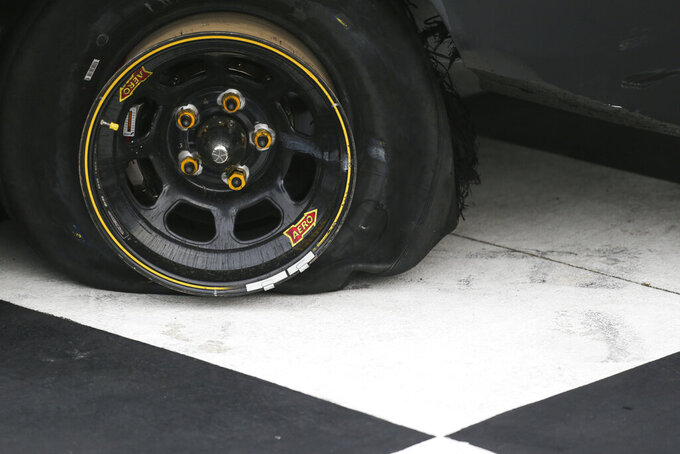 The rear left tire on Ty Gibbs' car is deflated after a burnout following his victory in a NASCAR Xfinity Series auto race at Watkins Glen International in Watkins Glen, N.Y., on Saturday, Aug. 7, 2021. (AP Photo/Joshua Bessex)