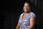 In this Friday, Oct. 11, 2019, photo Tarana Burke, founder and leader of the #MeToo movement, poses for a portrait in New York. Burke is using the second anniversary of the movement to launch a new effort intended to mobilize voters heading into the 2020 election.  The new hashtag #MeTooVoter was unveiled Tuesday, Oct. 15 on the same day as the fourth Democratic presidential debate and reflects a frustration among activists that issues of sexual violence and harassment have largely been absent from the debate stage and campaign trail.  (AP Photo/Mary Altaffer)