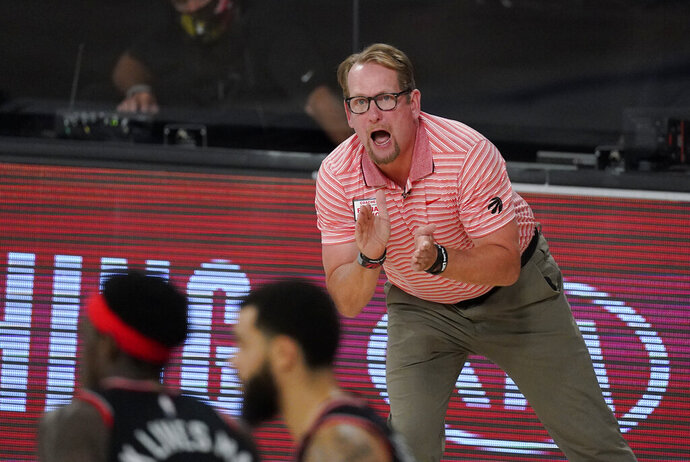 Toronto Raptors' head coach Nick Nurse reacts on the bench during the second half of an NBA conference semifinal playoff basketball game against the Boston Celtics Saturday, Sept. 5, 2020, in Lake Buena Vista, Fla. (AP Photo/Mark J. Terrill)