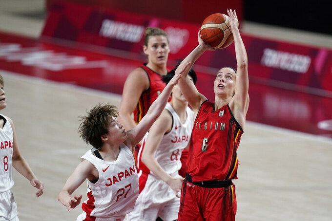 Belgium's Antonia Delaere (6) shoots over Japan's Saki Hayashi (27) during a women's basketball quarterfinal round game at the 2020 Summer Olympics, Wednesday, Aug. 4, 2021, in Saitama, Japan. (AP Photo/Charlie Neibergall)