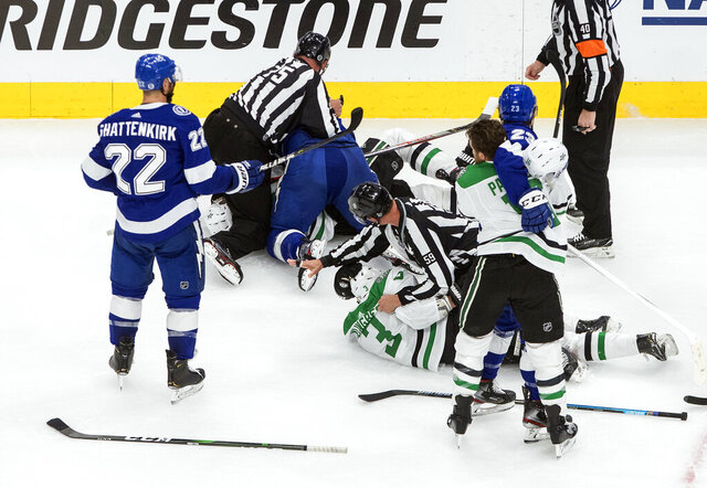 Dallas Stars and Tampa Bay Lightning players rough it up during second-period NHL Stanley Cup finals hockey action in Edmonton, Alberta, Monday, Sept. 21, 2020. (Jason Franson/The Canadian Press via AP)