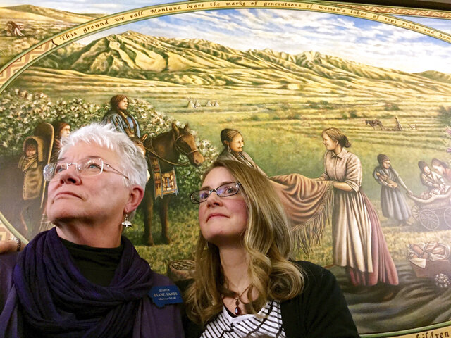 FILE - In this Jan. 7, 2015, file photo, State Sen. Diane Sands, left, and artist Hadley Ferguson of Missoula stand in front of a mural honoring Montana women as community builders at its unveiling at the state Capitol in Helena, Mont. Members of the Montana Democratic Party met remotely on Friday, June 5, 2020, to vote on the party's platform, including the addition of a statement in reaction by the death of George Floyd opposing the use of force by law enforcement during arrests. Sen. Diane Sands, D-Missoula, who led a Zoom meeting on the party's crime and justice platform, voiced support for the amendment.