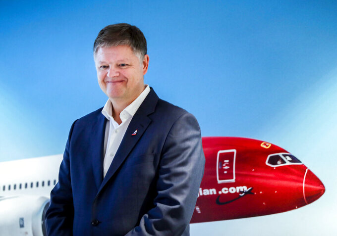 """FILE - In this Wednesday, Nov. 20, 2019 file photo, Jacob Schram poses for the media after being announced as the new CEO of Norwegian Air Shuttle, in Oslo. Low-cost carrier Norwegian Air Shuttle """"has been saved,"""" top boss CEO Jacob Schram said Wednesday May 26, 2021, adding it had """"written history"""" as the ailing airline had struggled with the fallout of the coronavirus pandemic and a debt restructuring plan. (Vidar Ruud/NTB Scanpix via AP, File)"""