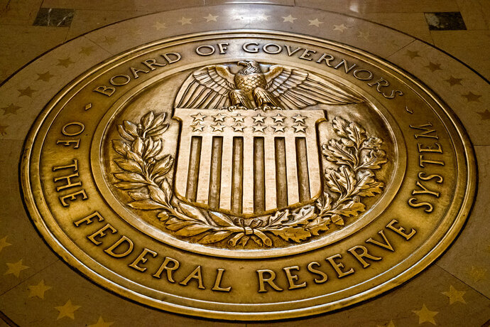 FILE- In this Feb. 5, 2018, file photo, the seal of the Board of Governors of the United States Federal Reserve System is displayed in the ground at the Marriner S. Eccles Federal Reserve Board Building in Washington. Richard Clarida, President Donald Trump's nominee for the No. 2 post at the Federal Reserve, pledged on Tuesday, May 15, to support the Fed's twin goals of stabilizing inflation and maximizing employment while also declaring the importance of the central bank's independence. (AP Photo/Andrew Harnik, File)