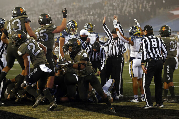 Army defensive back Marquel Broughton (20) reacts after stopping Navy at the goal line during the second half of an NCAA college football game Saturday, Dec. 12, 2020, in West Point, N.Y.  (AP Photo/Adam Hunger)