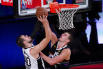 Los Angeles Clippers' Ivica Zubac (40) has his shot blocked by Denver Nuggets' Nikola Jokic (15) during the second half of an NBA conference semifinal playoff basketball game, Wednesday, Sept. 9, 2020, in Lake Buena Vista, Fla. (AP Photo/Mark J. Terrill)