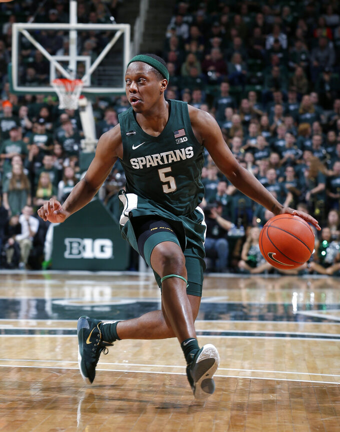 FILE - In this Feb. 4, 2020, file photo, Michigan State's Cassius Winston drives against Penn State during the second half of an NCAA college basketball game in East Lansing, Mich. Winston was selected to the Associated Press All-Big Ten team selected Tuesday, March 10, 2020. (AP Photo/Al Goldis, File)