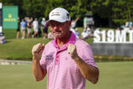 Alex Cejka, of Germany, reacts after defeating Steve Stricker on the first hole of a playoff after the final round of the Regions Tradition PGA Tour Champions golf tournament Sunday, May 9, 2021, in Hoover, Ala. (AP Photo/Butch Dill)