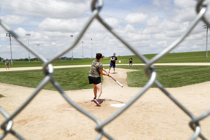 Visitors play on the field at the Field of Dreams movie site, Friday, June 5, 2020, in Dyersville, Iowa. Major League Baseball is building another field a few hundred yards down a corn-lined path from the famous movie site in eastern Iowa but unlike the original, it's unclear whether teams will show up for a game this time as the league and its players struggle to agree on plans for a coronavirus-shortened season. (AP Photo/Charlie Neibergall)