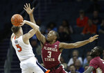 Virginia's Kyle Guy (5) tries to shoot over Florida State's Trent Forrest (3) during the first half of an NCAA college basketball game in the Atlantic Coast Conference tournament in Charlotte, N.C., Friday, March 15, 2019. (AP Photo/Nell Redmond)