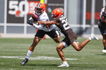 Cleveland Browns cornerback Greg Newsome II (20) breaks up a pass intended for wide receiver KhaDarel Hodge (12) during an NFL football practice Thursday, Aug. 12, 2021, in Berea, Ohio. (AP Photo/Ron Schwane)