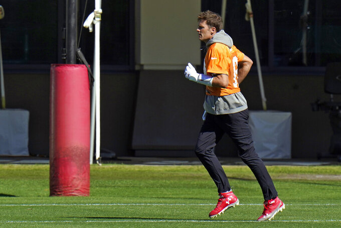 Tampa Bay Buccaneers quarterback Tom Brady (12) runs during an NFL football workout Thursday, Jan. 28, 2021, in Tampa, Fla. The Buccaneers play the Kansas City Chiefs in Super Bowl LV on Feb. 7. (AP Photo/Chris O'Meara)